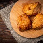 smoked-chicken-thigh-wooden-board-dark-wooden-background_176402-6812